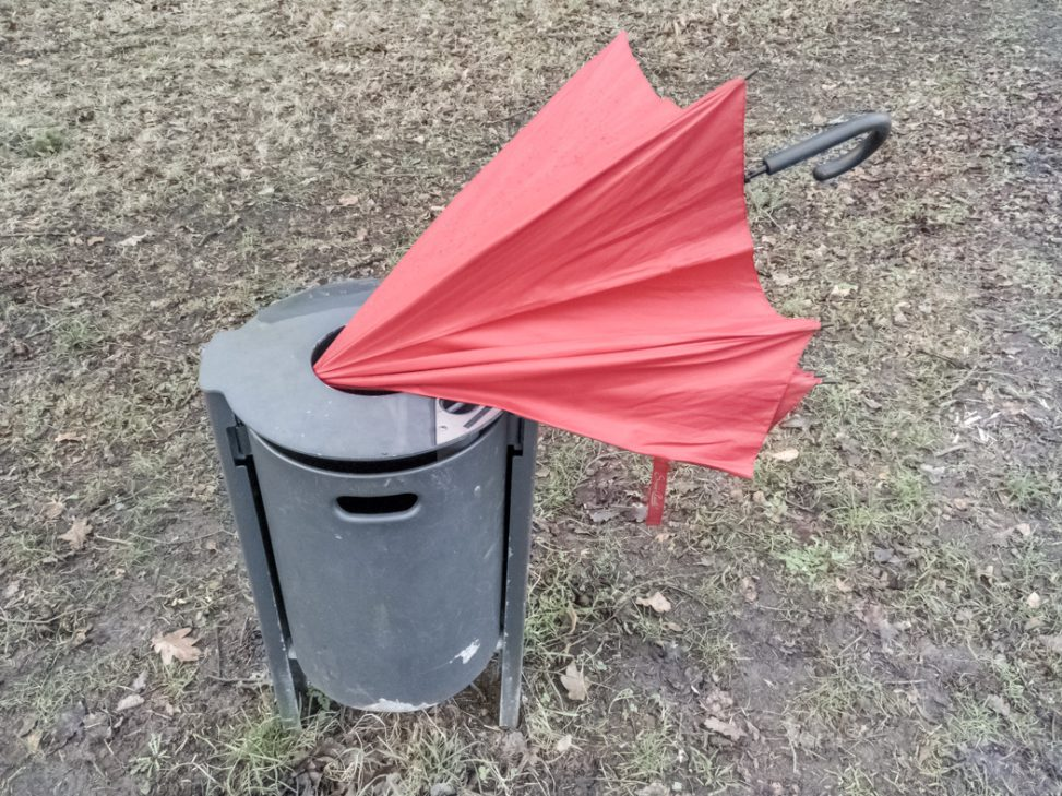 Umbrella in a dustbin